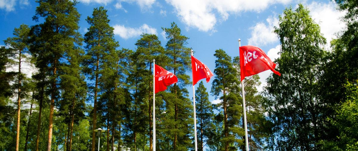 Helvar flags outside Karkkila factory during summer